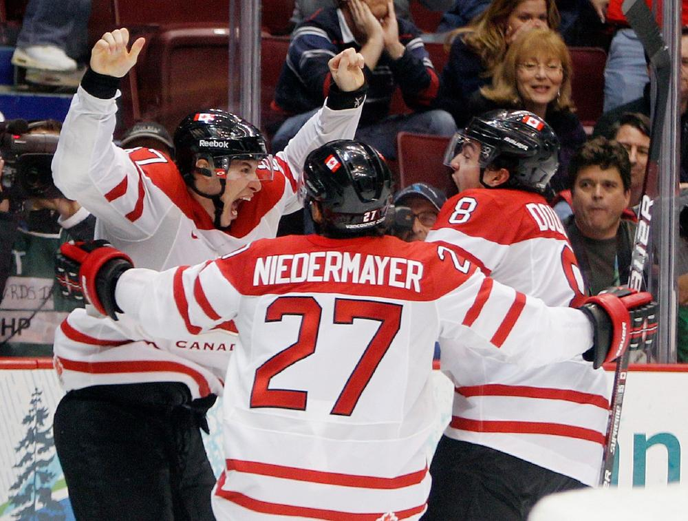 Canada's Sidney Crosby (87) is congratulated by Drew Doughty (8) and Scott Niedermayer (27) after Crosby scored the game-winning goal in the overtime period of a men's gold medal ice hockey game against the U.S. at the Vancouver 2010 Olympics in Vancouver on Sunday. (AP)