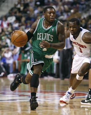 Celtics guard Nate Robinson drives around Pistons guard Rodney Stuckey during Tuesday's game. (AP)