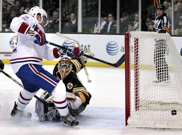 Montreal Canadiens left wing Mathieu Darche scores against Boston Bruins goalie Tuukka Rask during Tuesday's game in Boston. (AP)