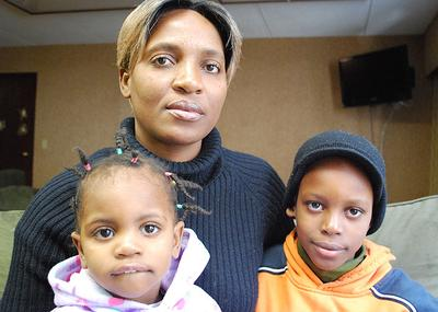 Marie Honore Milice and her children are homeless after coming to the Boston area following Haiti's devastating Jan. 12 earthquake. The family is staying at a hotel in Woburn.  (Bianca Vazquez Toness/WBUR)