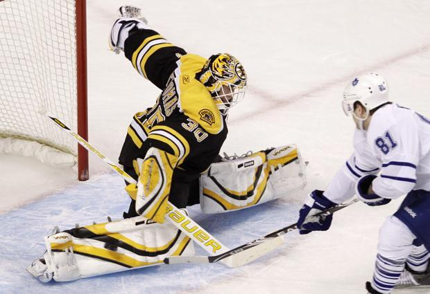 Bruins goalie Tim Thomas, left, makes a save on a shot by Maple Leafs right wing Phil Kessell during Thursday's game in Boston. (AP)