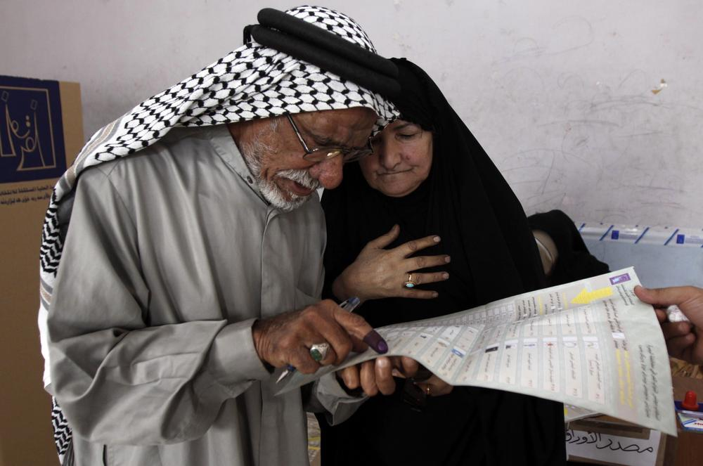 Jabbar Swaiyed, 72, and his wife look over a ballot before casting their vote in Basra, Iraq's second-largest city on March 7, 2010. (AP Photo/Nabil al-Jurani)