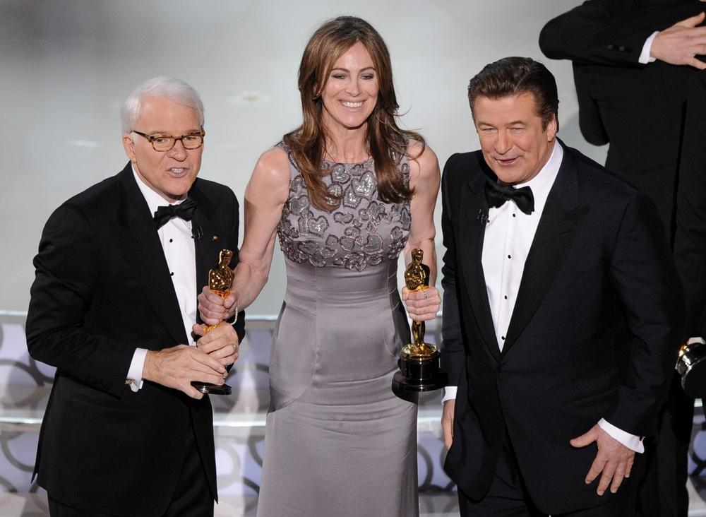 "Kathryn Bigelow, center, holds her Oscars for best motion picture of the year and best achievement in directing for ""The Hurt Locker"" with hosts Alec Baldwin, right, and Steve Martin at the conclusion of the 82nd Academy Awards on Sunday. (AP Photo)"