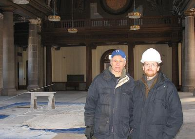 Richard Thal, left, and Brian Goldson stand within the under-construction Blessed Sacrament church in Jamaica Plain. (Monica Brady-Myerov/WBUR)