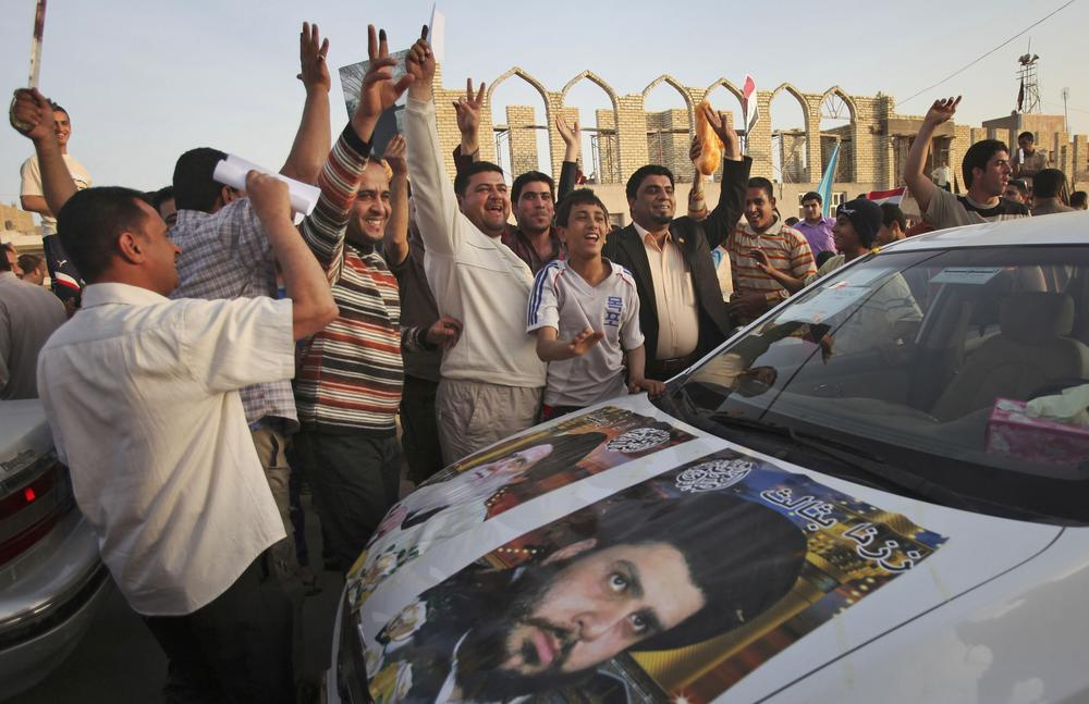 Supporters of anti-American Shiite cleric Muqtada al-Sadr celebrate on the streets of Sadr City in Baghdad, Iraq today (AP)