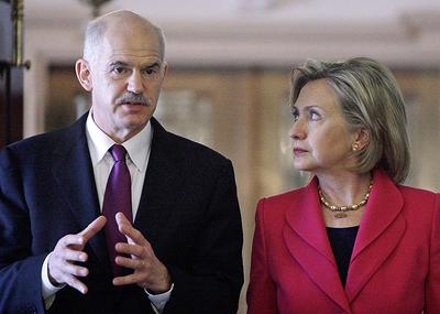 U.S. Secretary of State Hillary Rodham Clinton and Greek Prime Minister George Papandreou take part in a news conference in Washington on Monday. (AP)