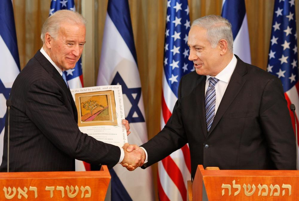 U.S. Vice President Joe Biden shakes hands with Israel's Prime Minister Benjamin Netanyahu at the prime minister's residence  in Jerusalem on Tuesday. (AP)