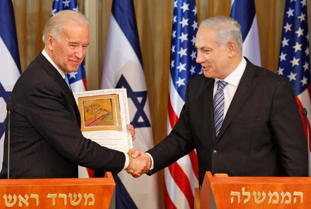 U.S. Vice President Joe Biden shakes hands with Israel's Prime Minister Benjamin Netanyahu at the prime minister's residence  in Jerusalem on Tuesday. (AP)