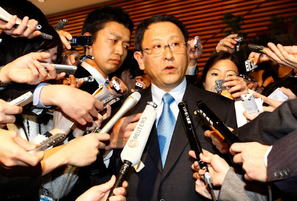 Toyota President Akio Toyoda, center, answers reporters' questions after a meeting with Japanese Prime Minister Yukio Hatoyama in Tokyo on Monday. (AP)