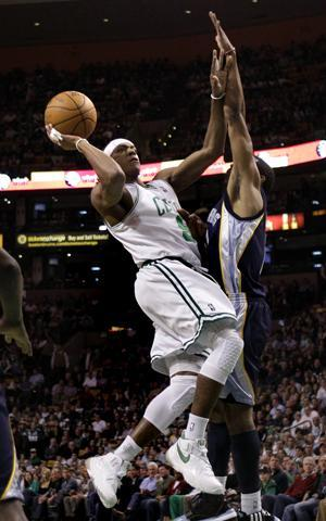 Celtics guard Rajon Rondo shoots against Grizzlies guard Mike Conley during Wednesday's game in Boston. (AP)