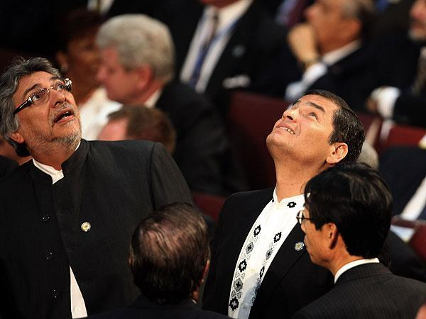 Paraguay's President Fernando Lugo, left, and Ecuador's President Rafael Correa react during an aftershock as Chile's President Sebastian Pinera was sworn into office in Valparaiso, Chile on Thursday. (AP)