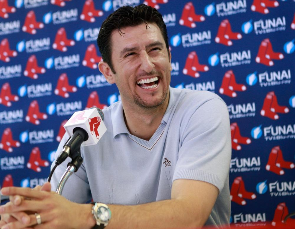 Former Boston Red Sox shortstop Nomar Garciaparra takes questions during a news conference in Fort Myers, Fla. on Wednesday.  The 1997 American League MVP signed a one-day contract with his former team, then announced he's ending his 14-year career. (AP)