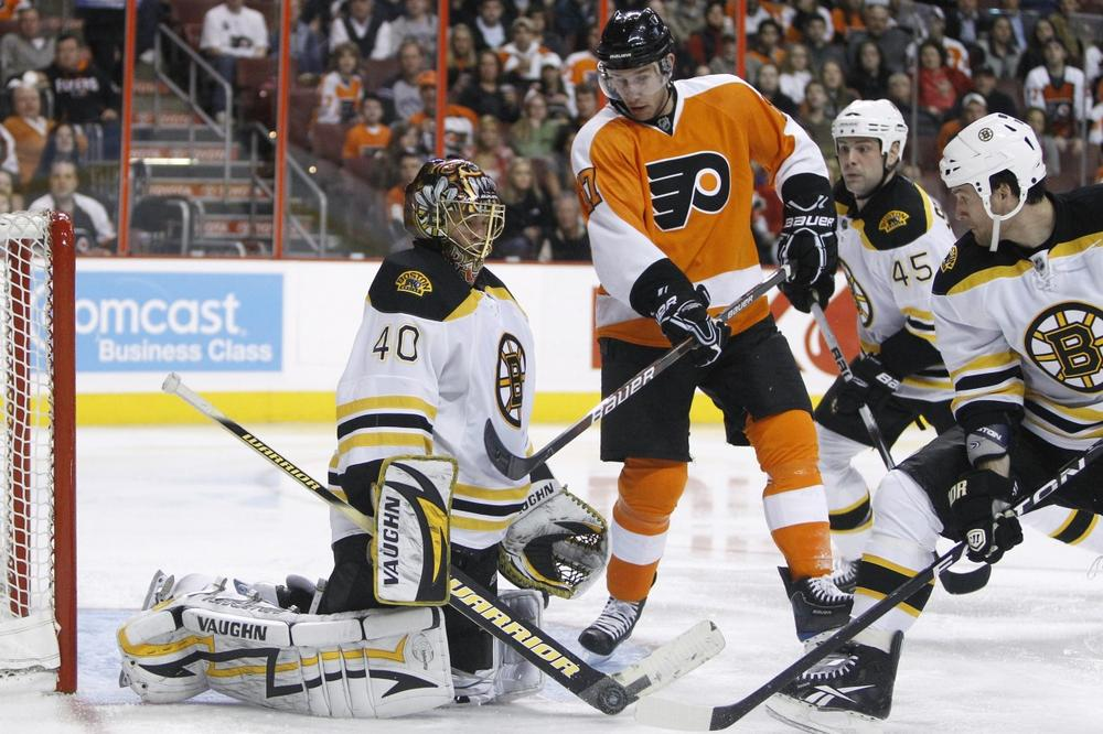 Philadelphia Flyers' Jeff Carter, center, has his shot blocked by Boston Bruins goalie Tuukka Rask, from left, as Mark Stuart and Dennis Wideman look on in the second period of Thursday night's game. (AP)