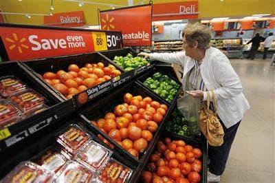 In this Tuesday, Nov. 10, 2009 photo, shopper Ann Murphy of Brooklawn N.J. gathers produce at a WalMart, in Deptford N.J. (AP Photo/Matt Rourke)
