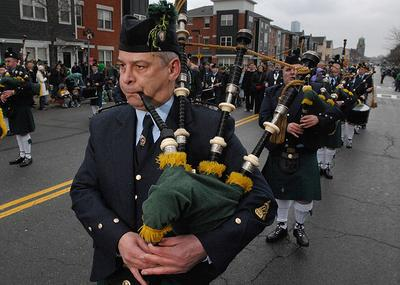 Pat Cosgrove plays bagpipes with the Irish Prison Service Pipe Band, of Dublin, Ireland, during the St. Patrick's Day Parade in South Boston on March 16, 2008. (AP)