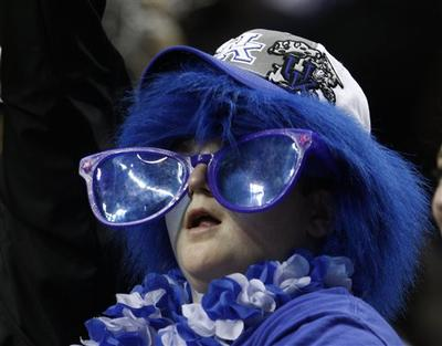 A Kentucky fan watches the championship game between Kentucky and Mississippi State at the NCAA college basketball Southeastern Conference tournament on Sunday, March 14, 2010, in Nashville, Tenn. (AP Photo/Wade Payne)