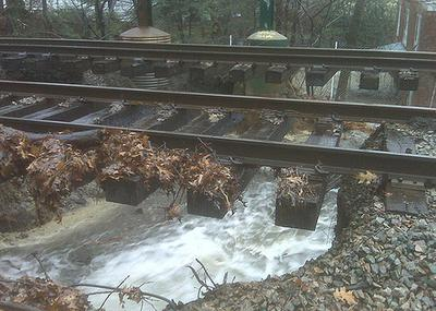 Flooding has caused a sinkhole to develop beneath the Green Line (D) subway between the Chestnut Hill and Newton Centre stations. (MassDOT/Flickr)
