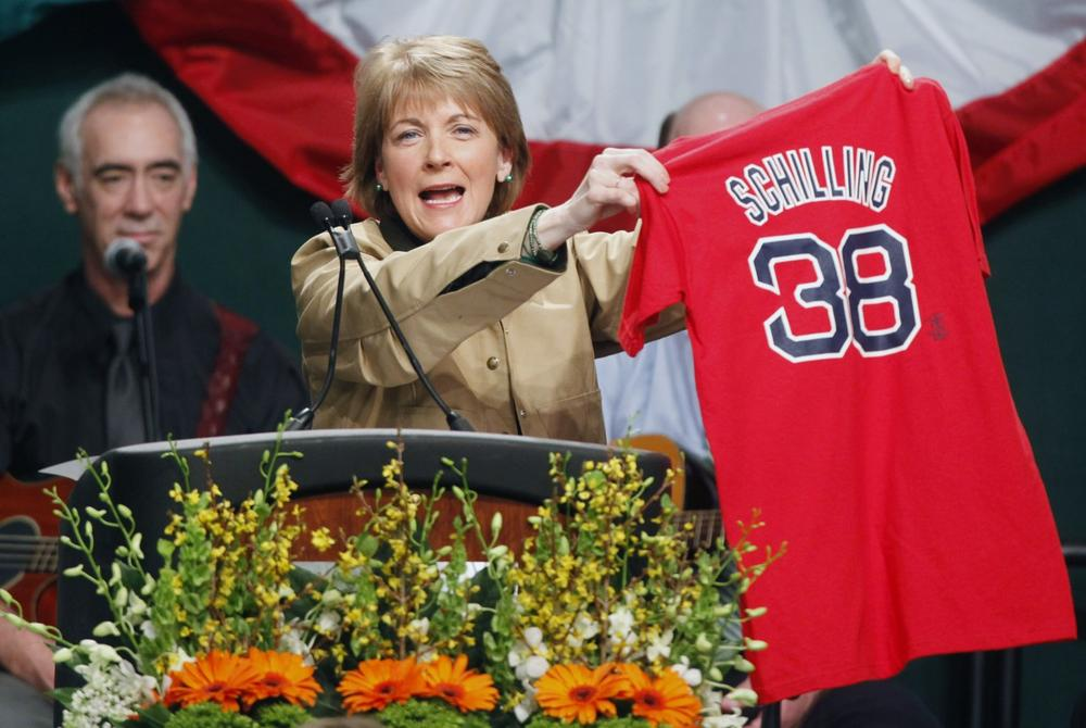 Massachusetts Attorney General Martha Coakley holds up a Red Sox jersey while speaking at the annual St. Patrick's Day breakfast in Boston on Sunday.  (AP)