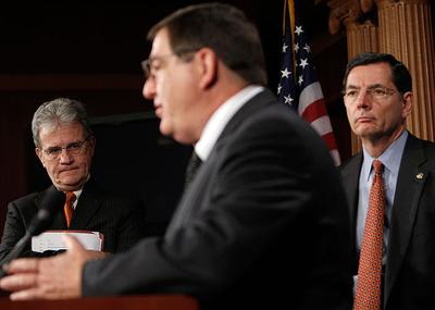 Sen. Tom Coburn, R-OK, left, and Sen. John Barrasso, R-WY, right, listen to Rep. Michael C. Burgess, R-Texas, during a news conference on health care with House GOP physicians in Washington on Thursday.(AP)