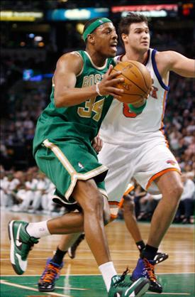 Boston Celtics' Paul Pierce drives to the basket ahead of New York Knicks' Danilo Gallinari during the second half of the game on Wednesday. (Mary Schwalm/AP)