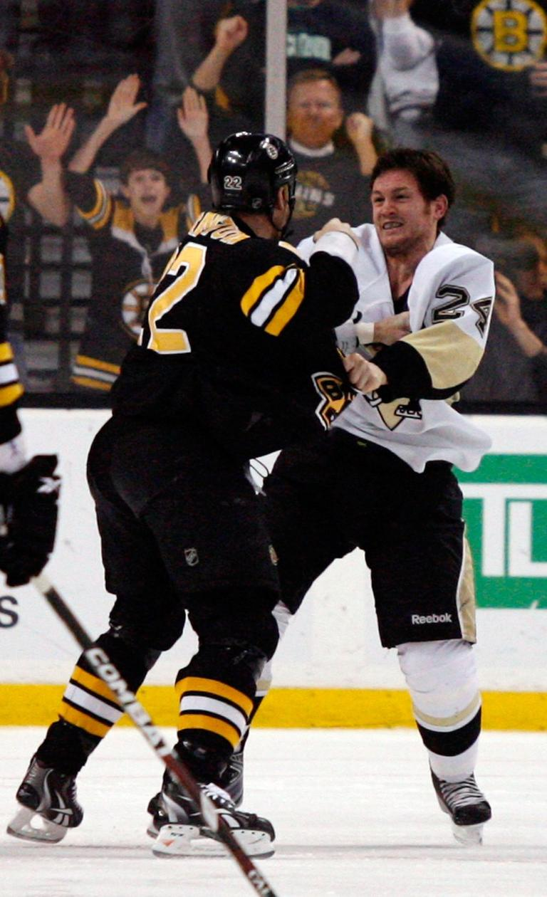 Boston Bruins' Shawn Thornton (22) fights with Pittsburgh Penguins' Matt Cooke (24) early in the the first period of an NHL hockey game on Thursday in Boston. (AP)