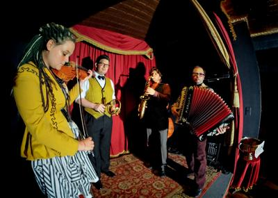 Cirkestra, which started as a circus pit band, is led by clown turned composer and accordionist Peter Bufano, right.