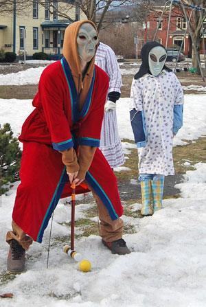 It can't be easy for an alien in a bathrobe to hit a croquet ball in winter. (Karen Given/WBUR)