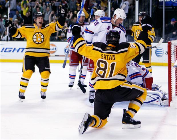 Boston Bruins' Andrew Ference, left, skates in to celebrate a goal by Miroslav Satan (81) in the second period on Sunday. (Michael Dwyer/AP)