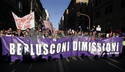 Purple People demonstrators in Rome last year carry a banner demanding the resignation of Italian premier Silvio Berlusconi (AP)