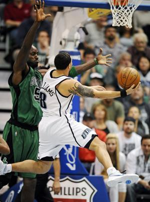 Jazz guard Deron Williams drives to the basket as Celtics forward Kevin Garnett defends during Monday's game. (AP)