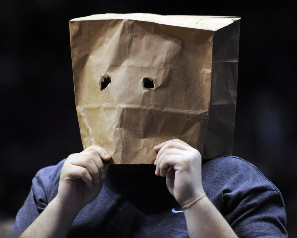 A fan with a paper bag over his head watches during an NBA basketball game between the New Jersey Nets and the Miami Heat on March 22 in East Rutherford, N.J. (AP)