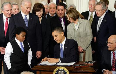 President Obama signs his landmark health care reform bill into law (AP)