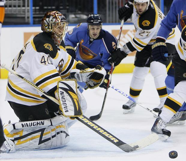 Bruins goalie Tuukka Rask turns away a shot during Tuesday's game in Atlanta. (AP)