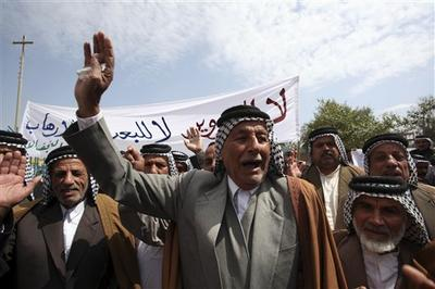 Supporters of Iraq's Prime Minister Nouri al-Maliki demand a manual recount of the elections (AP)