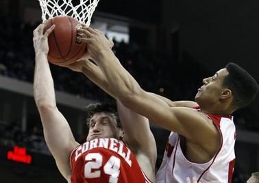 Cornell's Adam Wire (24) and Wisconsin's Ryan Evans fight over a rebound during the second half of an NCAA second-round college basketball game in Jacksonville, Fla. (AP)