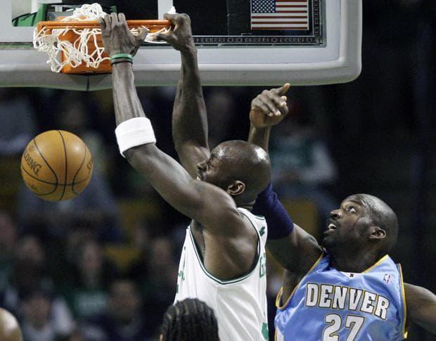 Celtics' Kevin Garnett dunks against Nuggets' Johan Petro during Wednesday's game in Boston. (AP)