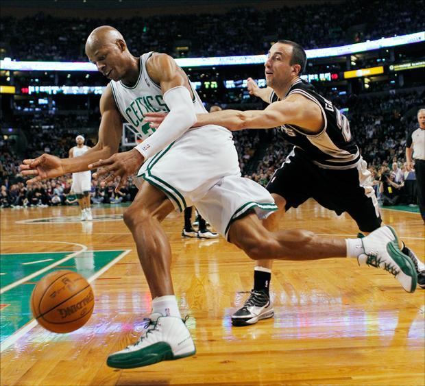 Celtics' Ray Allen, left, drives past San Antonio Spurs' Manu Ginobili in the first quarter on Sunday. (Michael Dwyer/AP)