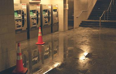 Water collects at the Kenmore T station. (Gabrielle Levy for WBUR)