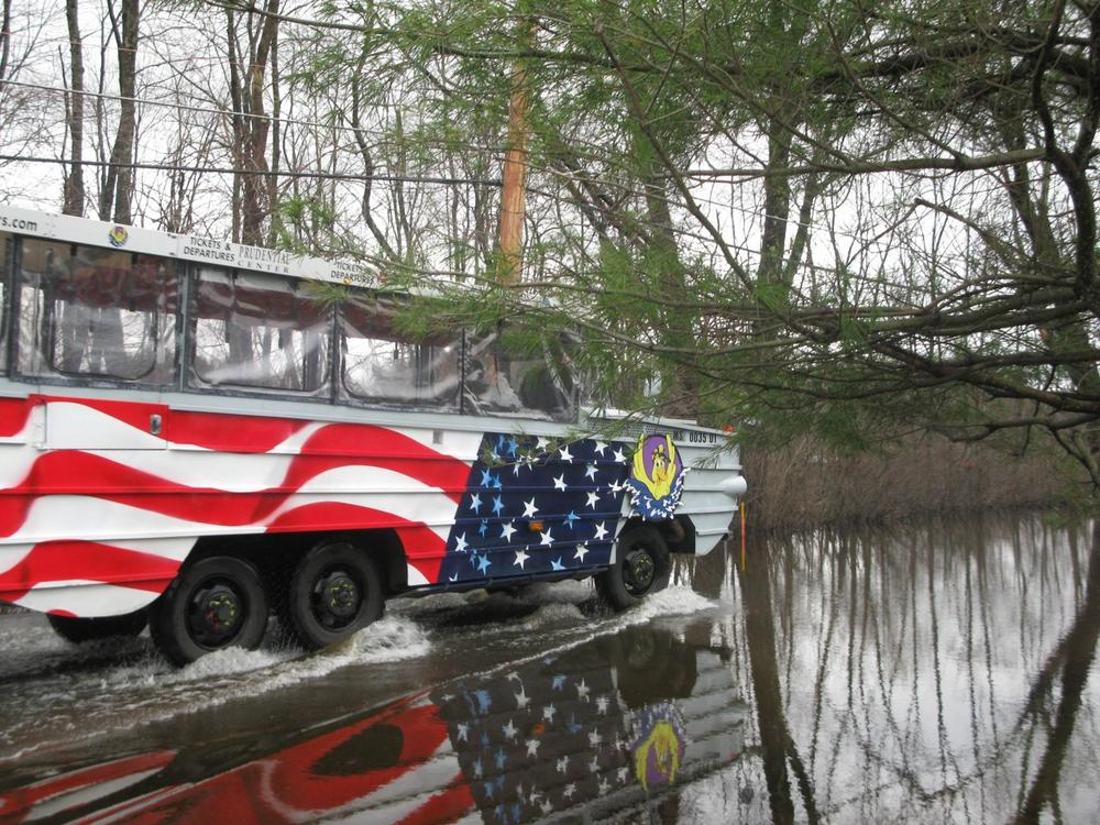 A duck boat ferries passengers to and from their homes in Wayland. (Fred Thys/WBUR)
