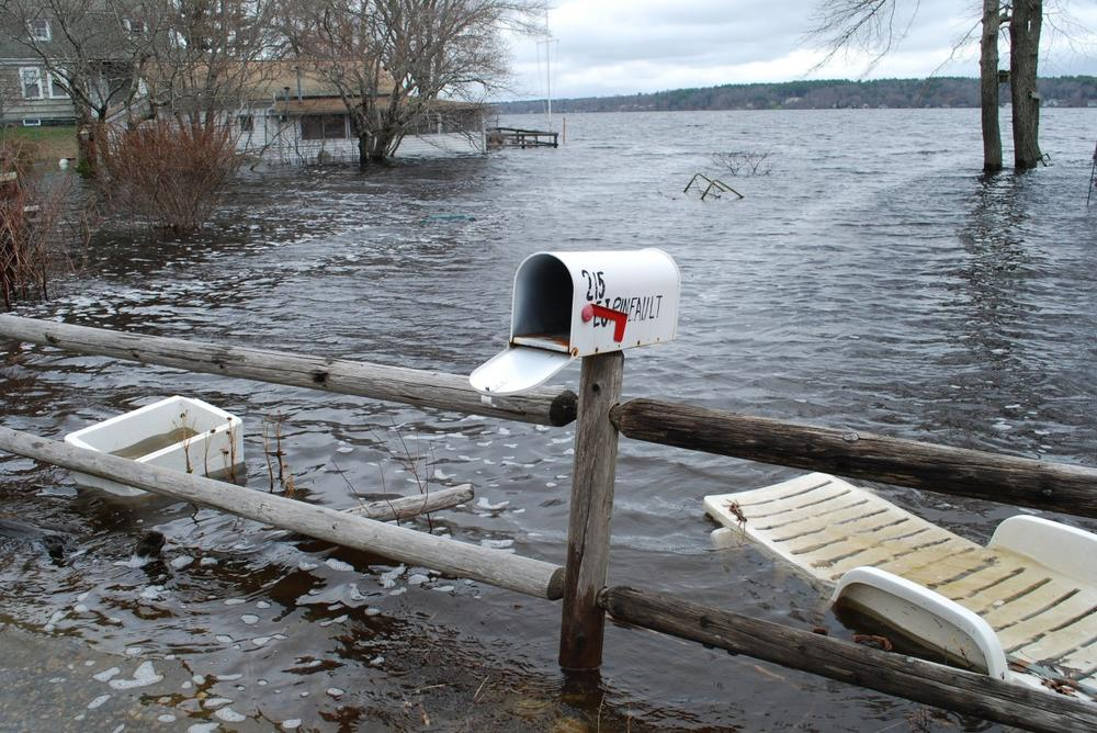 Water from Long Pond laps across Lakeville residents' yards, submerging their basements. (Bianca Vazquez Toness/WBUR)