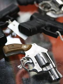 A chrome plated revolver rests on top of a glass display case at a store selling guns in New York. (AP)