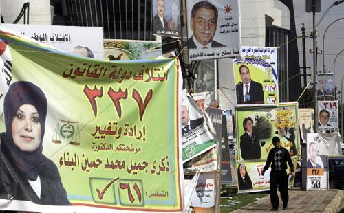 Election campaign posters are seen along a street in Baghdad, Iraq, on Monday, March. 1, 2010. Iraq's national election is set for March 7. (AP)
