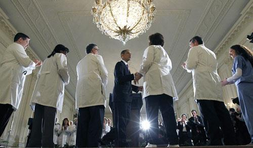 President Barack Obama shakes hands with health care professionals after speaking about health care reform, Wednesday, March 3, 2010, in the East Room of the White House. (AP)