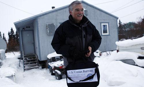 U.S. Census Bureau Director Robert Groves leaves the home of World War II veteran and village elder Clifton Jackson, 89, in the remote Inupiat Eskimo village Noorvik, Alaska., Monday, Jan 25, 2010, after counting him to formally launch the nation's 2010 census. (AP)