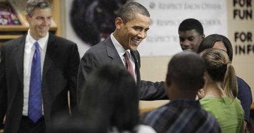 Education Secretary Arne Duncan looks on at left as President Barack Obama meets with students at Wright Middle School in Madison, Wis., Wednesday, Nov. 4, 2009. (AP)