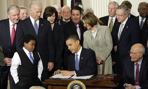 President Barack Obama signs the health care bill in the East Room of the White House in Washington on Tuesday, March 23, 2010. (AP)