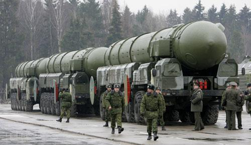 Russian troops are seen near truck-mounted Topol-M intercontinental ballistic missiles as they rehearse for the Victory Day parade in Moscow's Red Square, at a training field in the town of Alabino outside Moscow, Tuesday, March 18, 2008. (AP)