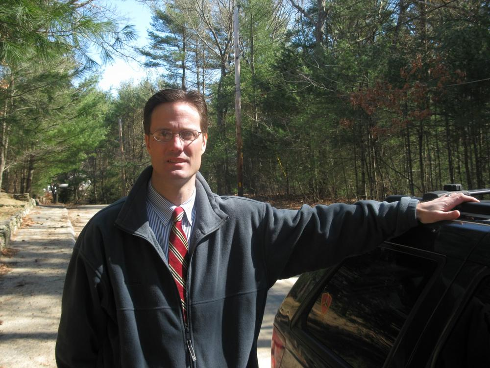 Ben Quelle campaigns in the woods of Plympton with his Jeep Cherokee. (Fred Thys/WBUR)