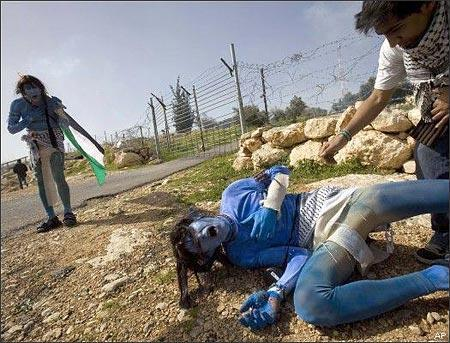 Protesters in the West Bank village of Bilin last month (AP)