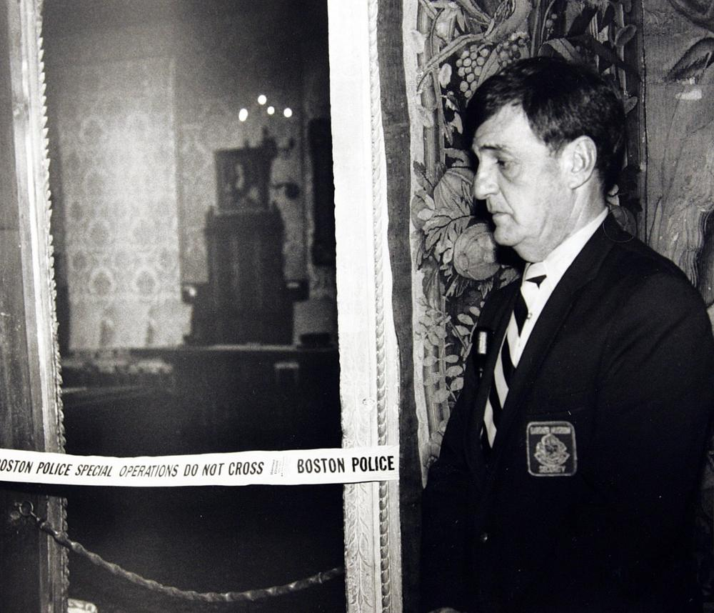 A security guard stands March 21, 1990, outside the Dutch Room of the Isabella Stewart Gardner Museum, where robbers stole more than a dozen works of art in an early morning robbery in Boston. (AP)